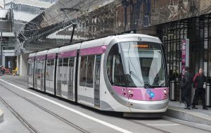 The first Midland Metro tram, number 37, named after Birmingham's most famous son Ozzy Osbourne, leaves New Street Station for the launch of the extended line.