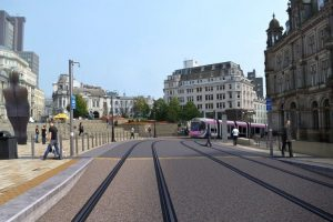 Tram arriving at Victoria Square in front of the Town Hall